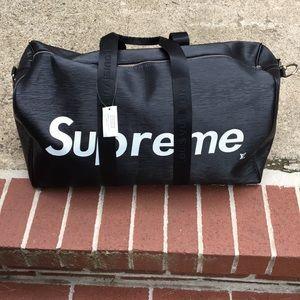 6df41454788e Supreme Bags - Louis Vuitton x Supreme Keepall Bandouliere Epi 55